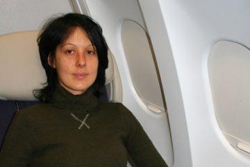 Nathalie, installée dans l'avion