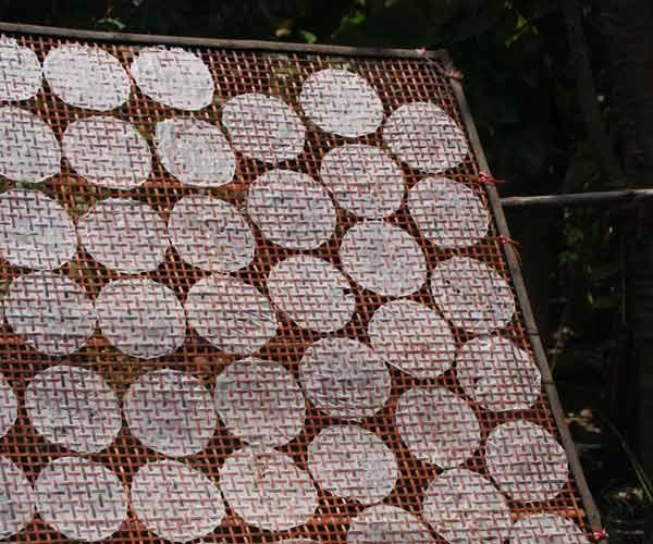 Treillis en bambou pour sécher les feuilles de riz
