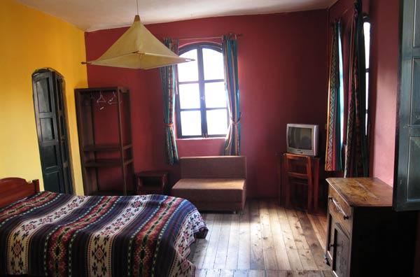 Chambre de l'hôtel Riviera Sucre à Otavalo